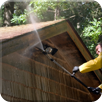 Man Pressure-washing the Roof